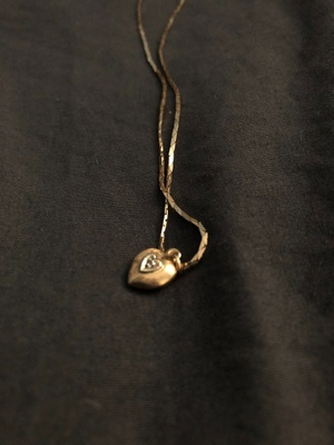 gold necklace with small golden heart