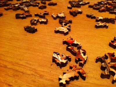 Intricate wooden puzzle pieces