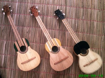 The cuatro is made out of wood and has four strings and is smaller than an American guitar
