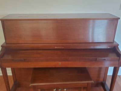A wooden upright piano