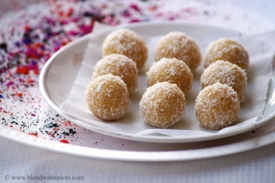 Gur Laddu - a sweet dish made out of jaggery, coconut, and milk solids