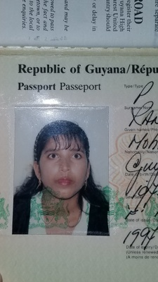 In her 1997 Guyanese passport, my mother stares forward, unaware of the future she would face in the United States with a new husband and a new life.