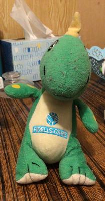 stuffed green and yellow dinosaur