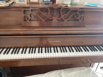 A brown Charles Walter piano, 88 keys.