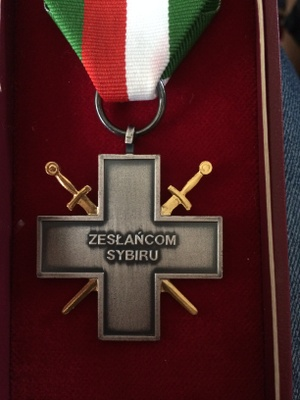 Metal cross back says Siberian Exiles Cross in Polish