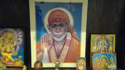 This is a photo of Sai Baba (center).