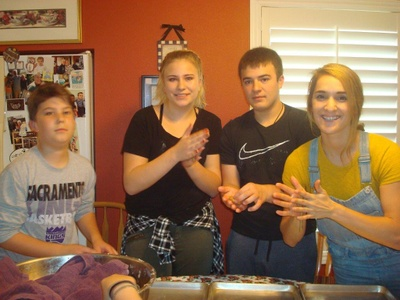 My cousins and I rolling the cookies.