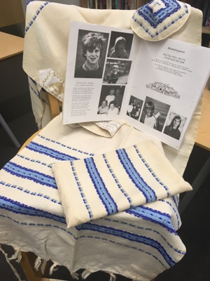 Blue and white tallit and kippah