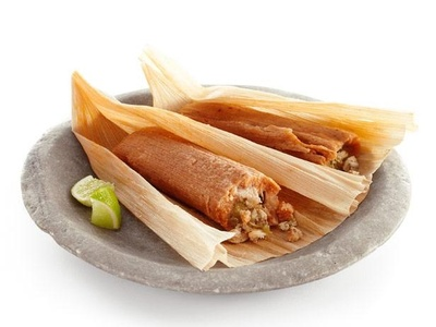 Chicken tamales on a plate.