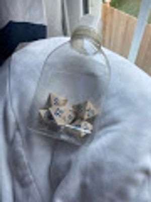 Clear bottle with wooden dice.