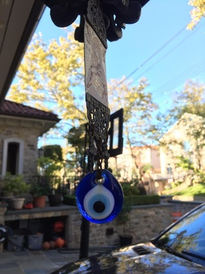 The Evil Eye hung up outside of my house.