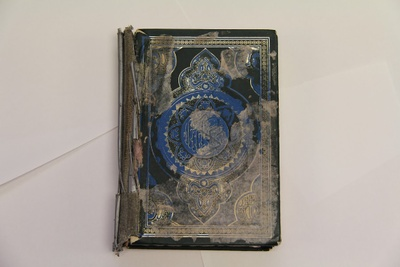 Quran, torn from the spine