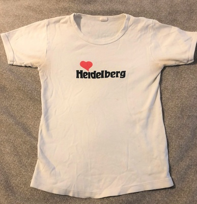 "White T-shirt with ""Heidelberg"" on it."