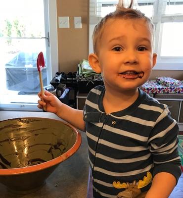 My son enjoying homemade chocolate avocado frosting.