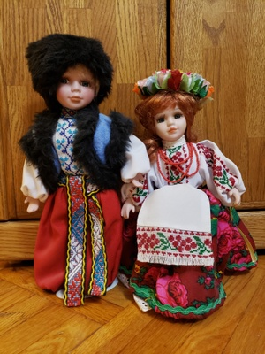 A boy and girl doll both dressed up in traditional Ukrainian attire.