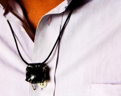 A Ta'wiz is worn around the neck.