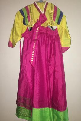 Hanbok is the name of this traditional Korean dress. It used to be worn by wealthy Koreans and the monarchy. Now, it is worn for special occasions like weddings and New Years.