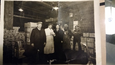 My great-grandfather (left), employees