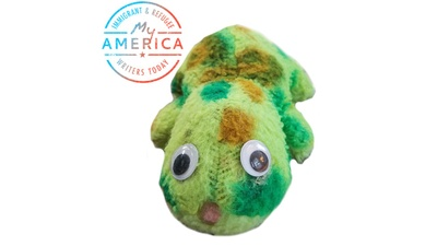 Stuffed felt frog toy.