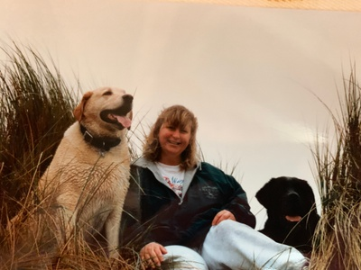 Pam at Stinson Beach with her dogs