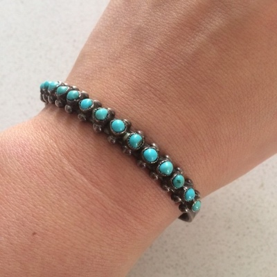 The bracelet, with fifteen turquoise stones, was a gift from my great-grandmother to my mother, to me.