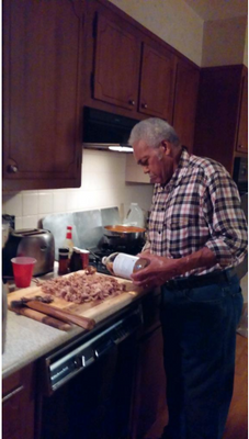 Grandpa making pulled pork