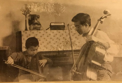 Me, with my first cello and my Father. The back piece of my cello was made from my bed.