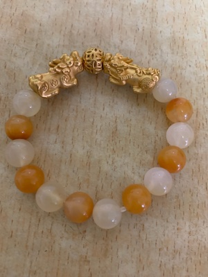 bracelet with golden lion clasp