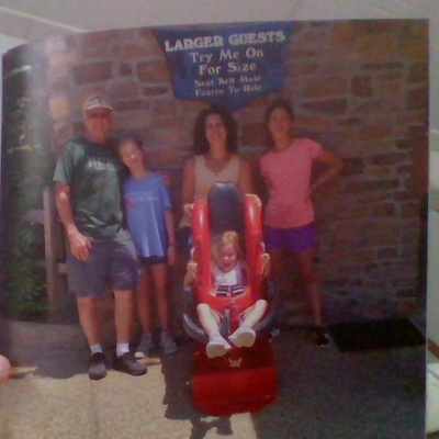 This is Kiara,her little sister,my mom and Kiara's grandfather at the entrance of a new ride that opened up.