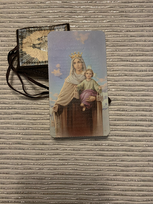 This Photo shows a scapular and prayer