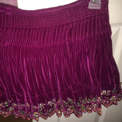 A velvet skirt with flower embriodery