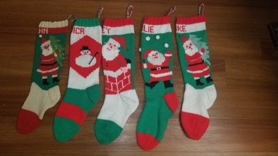A set of five knit Christmas stockings