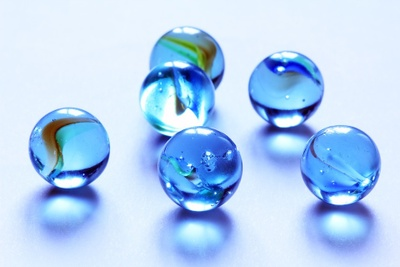 Marbles are small little balls.