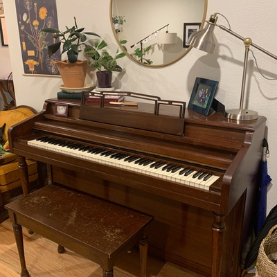 The piano, as it sits in our front room.