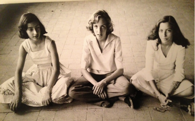 Three teenage girls sit cross-legged...
