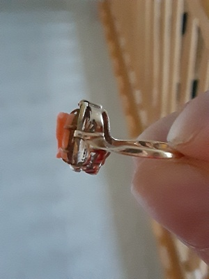 The ring is made out of gold and coral