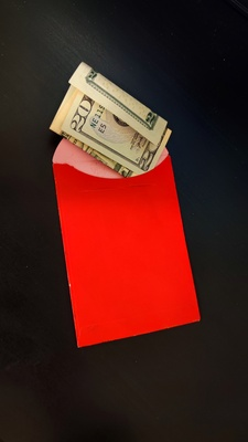 A red envelope with 20 dollars.