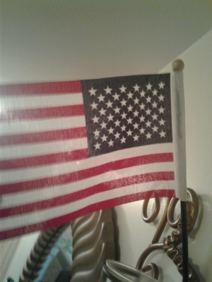 This is the flag that was given to my father after he finished his exam. The exam was so that he could be considered a citizen of the United . He passes the exam and was given this flag to show that he is now a citizen.