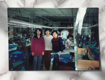 My mom with two of her friends at garment shop she worked at