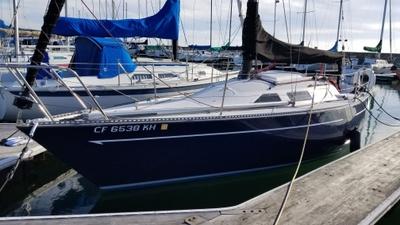 A sleek, white and blue sailboat