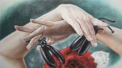 Hands of a flamenco dancer playing castanets