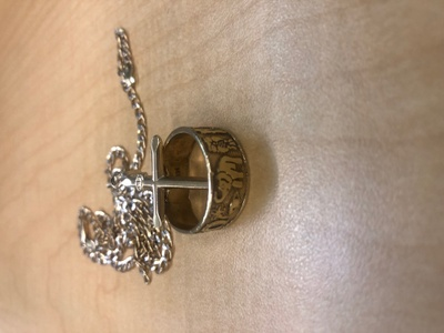 It is a golden chain, cross, and ring