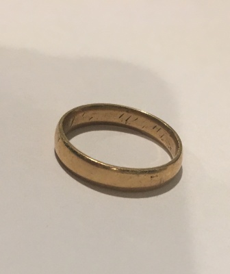 The ring is gold and very thin.