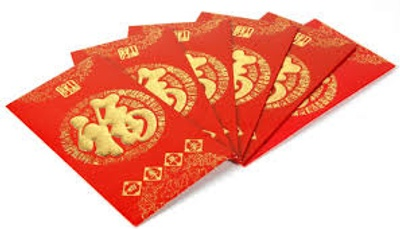 The object is red and has a fabric texture. The object has gold Chinese writing representing something in the language of Chinese.