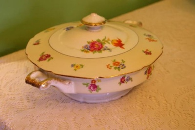 White porcelain soup tureen with pink flowers