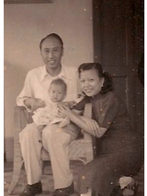 Me (baby) with my parents in HK 1951