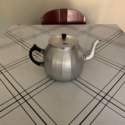 This is an aluminum teapot.