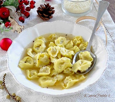 Ravioli meat and meat broth