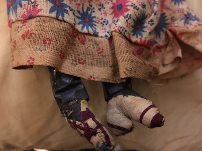 The doll wears heels