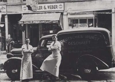 Ferdinand Schaller (Right) and Tony Weber (Left) in front of truck and store circa 1938